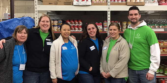 Community volunteering by Dane County Credit Union staff.