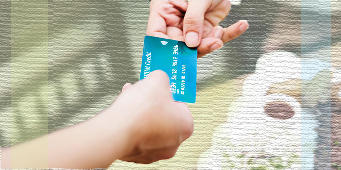 One hand offering your new Madison credit union credit card.