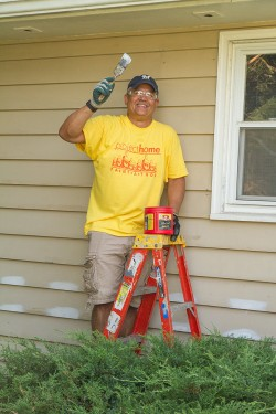 Shay volunteers with Project Home