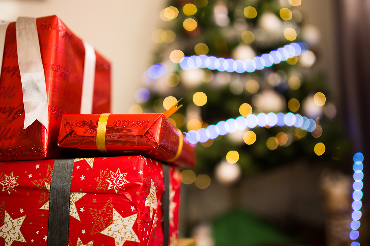 Christmas presents in front of tree