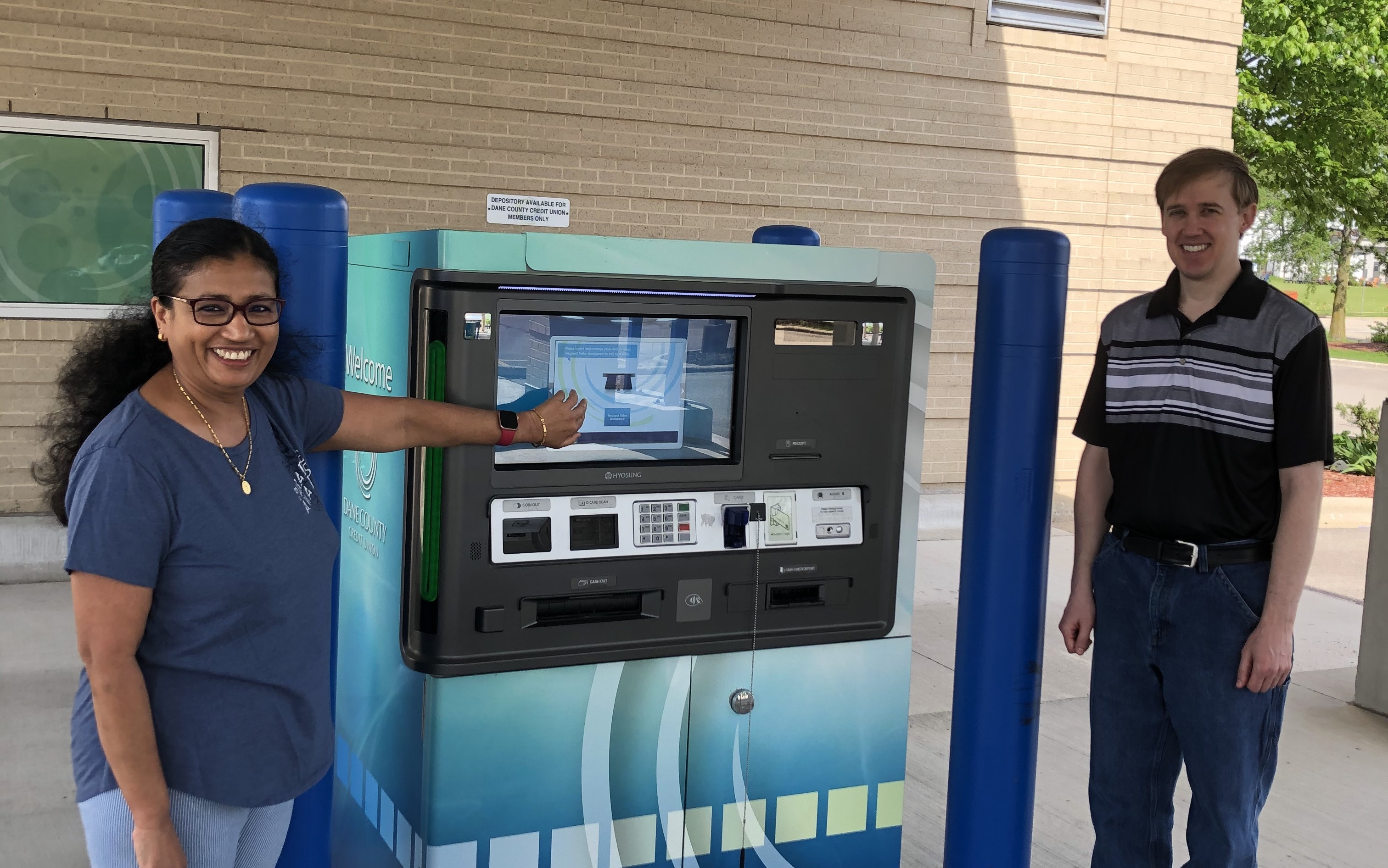 DCCU staff with Interactive Teller Machines