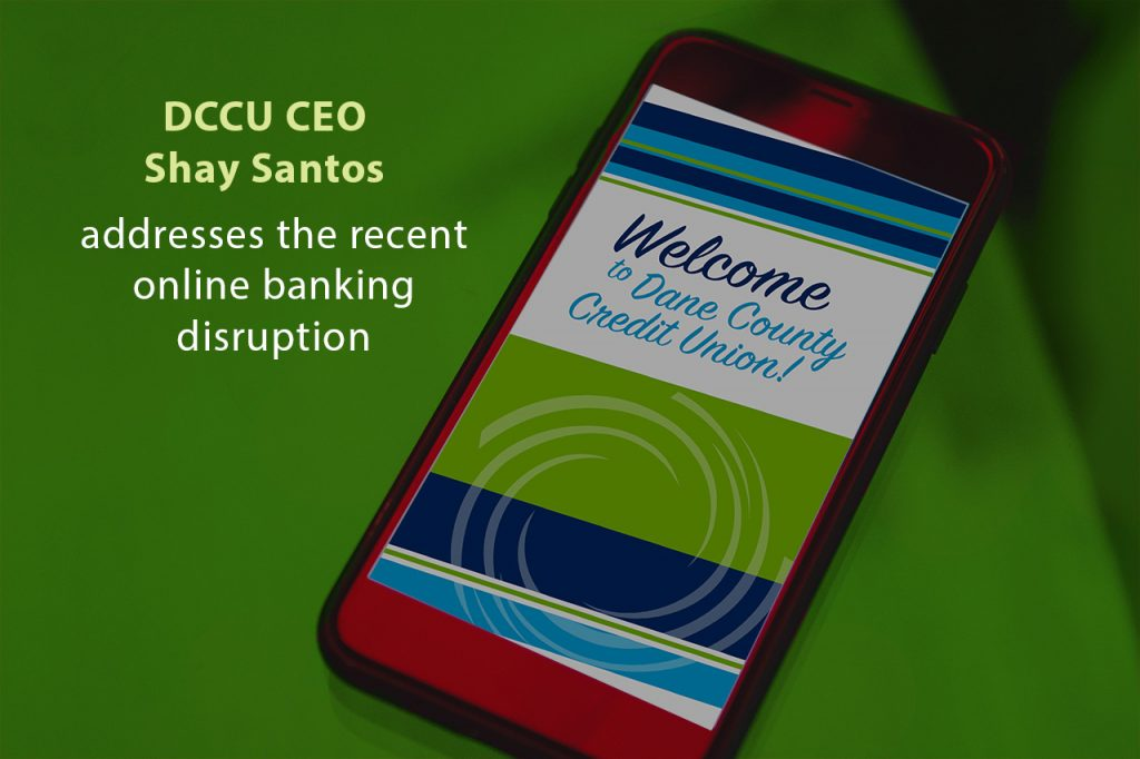 Mobile phone with DCCU online banking with message from DCCU CEO Shay Santos regarding online banking disruption.