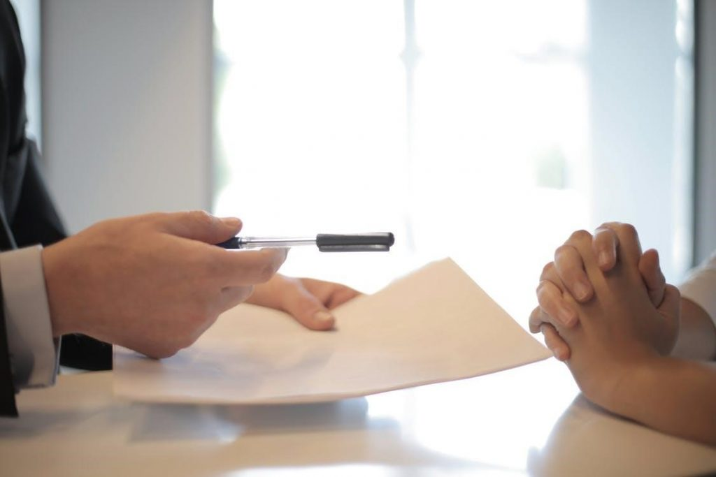 Businessman Giving Contract to Woman