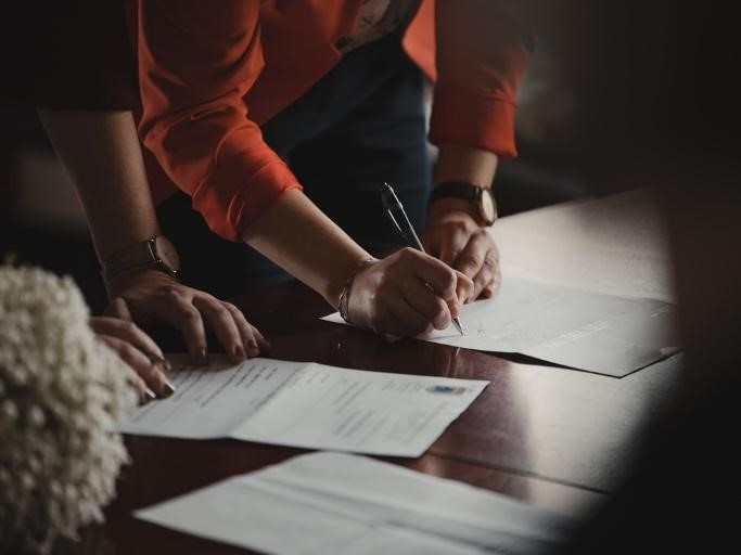 Person Signing Loan Agreements