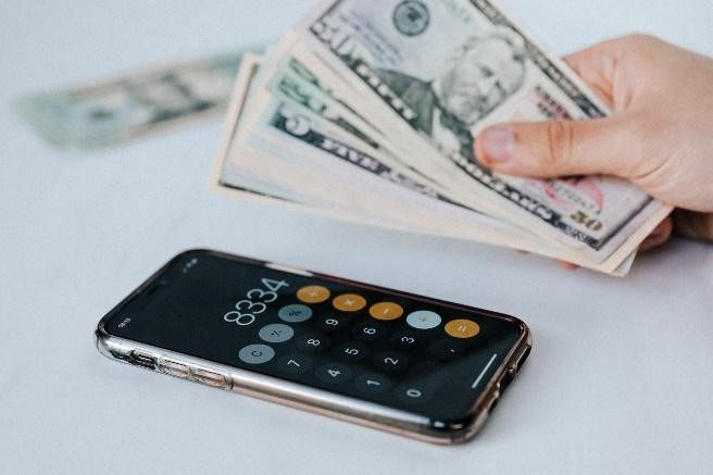 Person with Cash and Calculator App